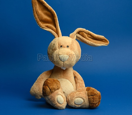funny beige plush rabbit with big