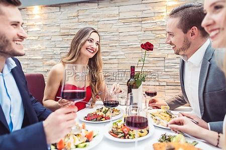 friends enjoying atmosphere food and drink