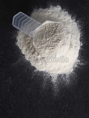 measuring spoon with protein powder on