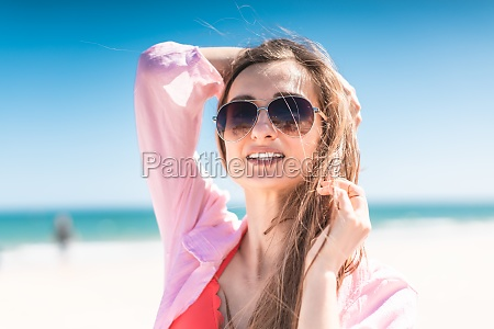 woman in swimwear backlit against a