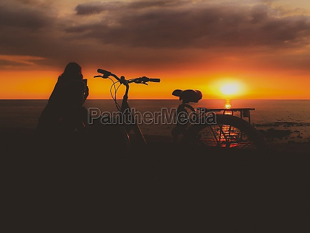 silhouette sunset coastal scene