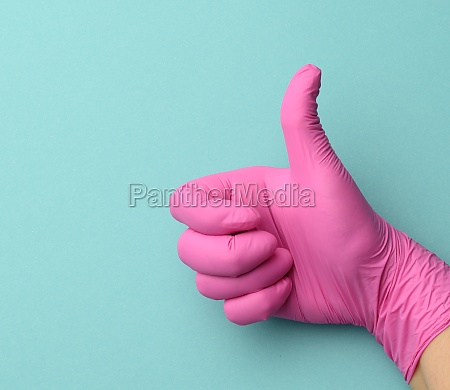 hand in pink medical glove shows