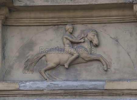 decoration showing a human riding a