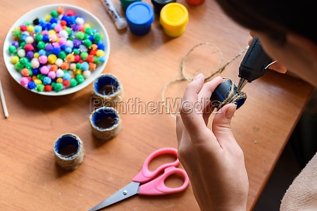 girls hands decorate elements with a