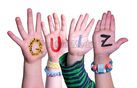 children hands building word quiz isolated