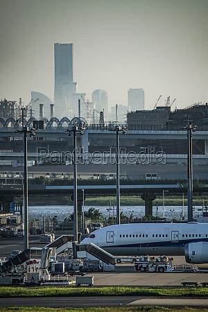 airplane and city silhouette haneda airport