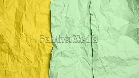 crumpled yellow and green sheets of