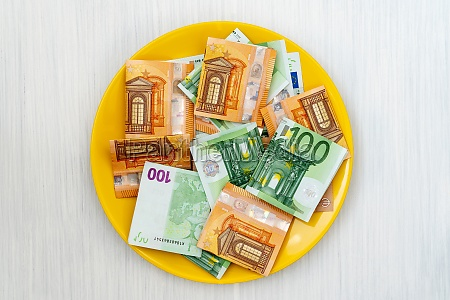plate with euro banknotes