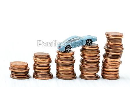 mini car model on stack of