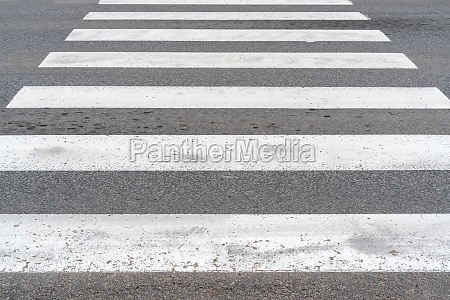 white crosswalk on asphalt