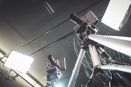 professional film camera on tripod broadcasting