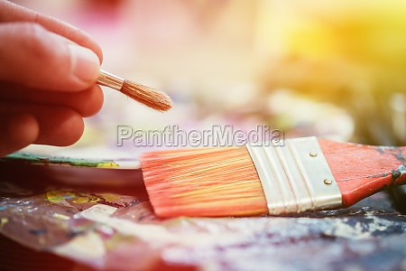 painting artwork paint brushes on painting