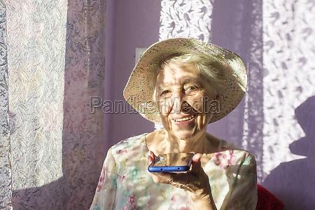 charming elderly woman in rectangular black