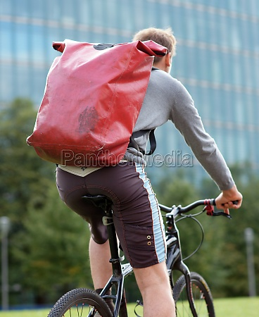 bicycle messenger in berlin delivering an