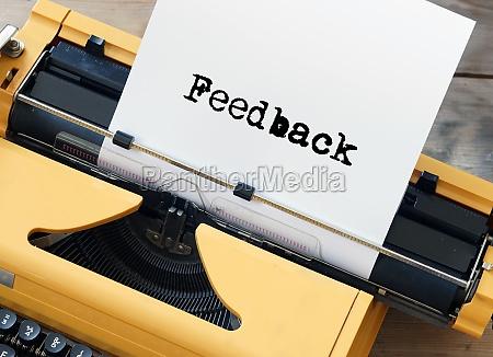 feedback typed on yellow vintage typewriter