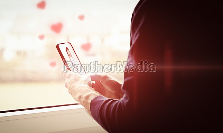 young man holding smartphone heart symbols