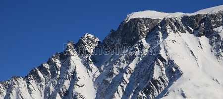 snow covered rugged mountain seen from