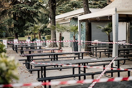 cordon tape around seating outside cafe