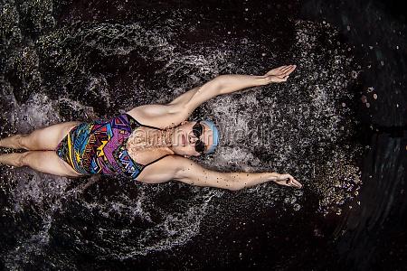 college elite swimmer in swimming pool