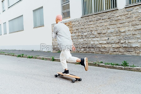 skateboarder on the move on street