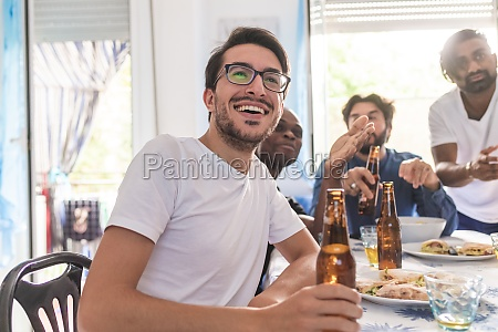 male friends having food and beer