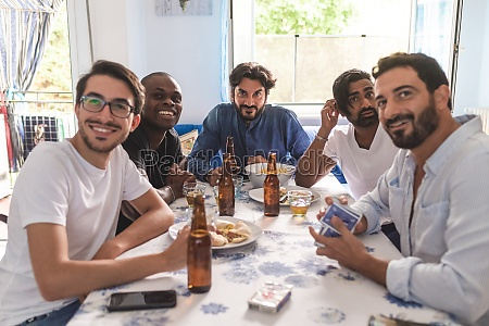male friends having card game