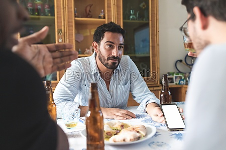 male friends having discussion over food
