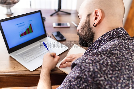 young man working on laptop at