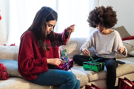 women wrapping gifts