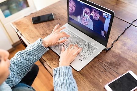 young woman having video call with