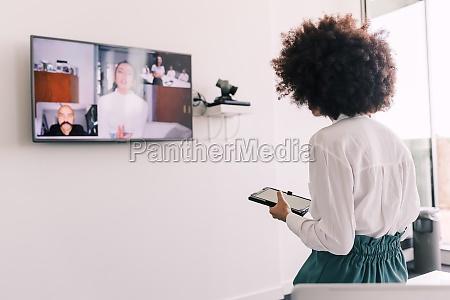 businesswoman in video meeting