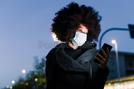 woman wearing face mask and looking
