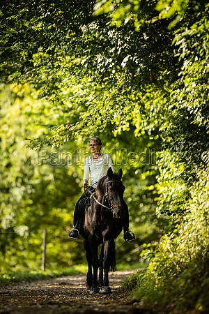 woman riding a horse equestrian sport