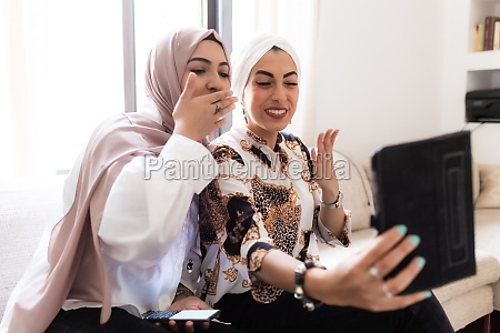 female friends having video call on