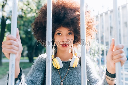 young woman holding onto railings