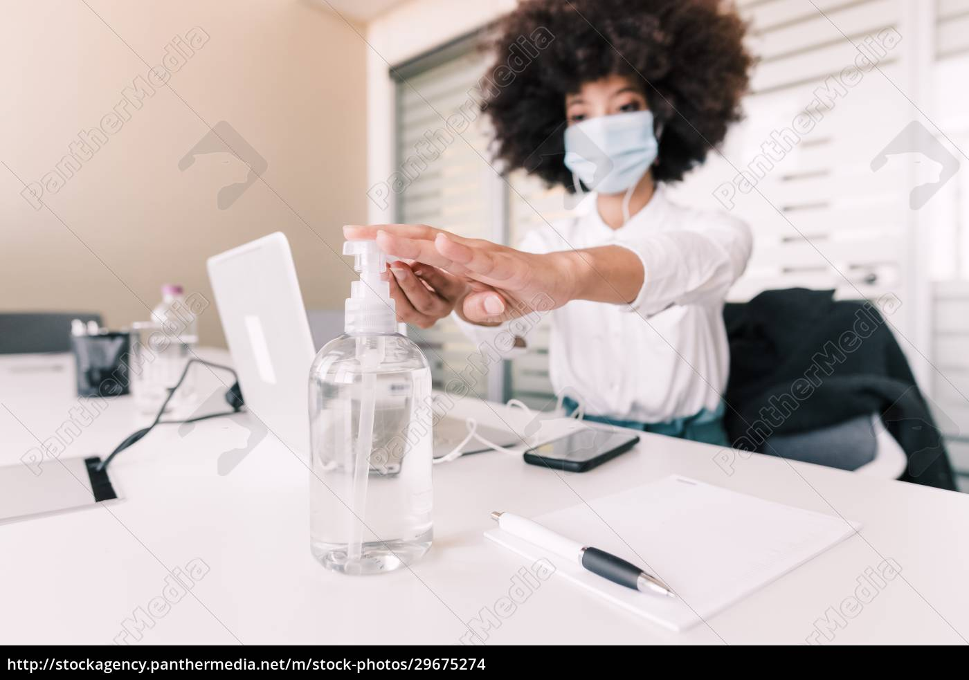 businesswoman, using, hand, sanitizer, at, her - 29675274
