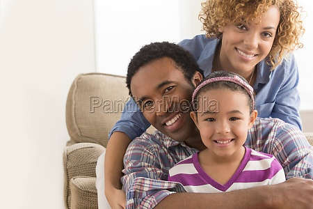 parents with arm around daughter portrait