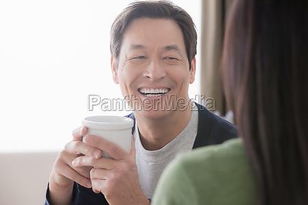 mature couple man holding coffee