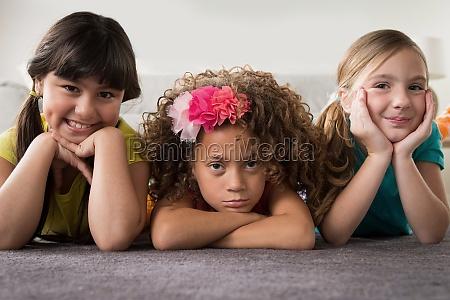 portrait of three girls lying on