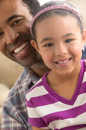 father and daughter smiling portrait