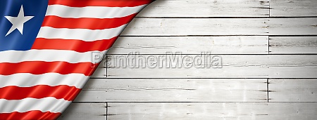 liberian flag on old white wall