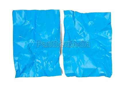 crumpled blue cardboard sheet of paper