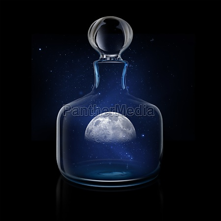 mysterious moon in glass decanter against