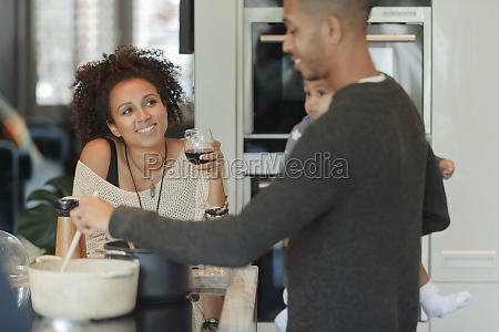happy couple with baby daughter drinking