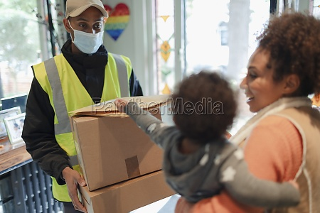 mother and baby daughter receiving packages