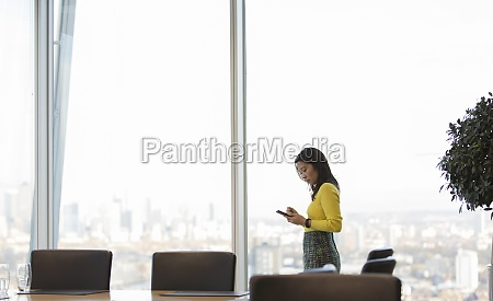 businesswoman using smart phone in highrise