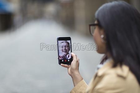 women friends video chatting on smart