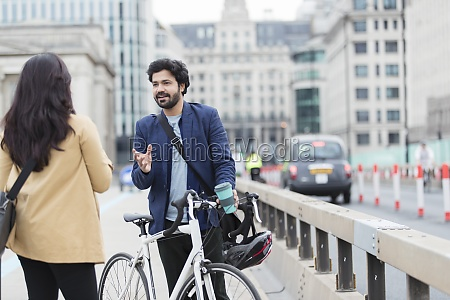business people with bicycle talking on