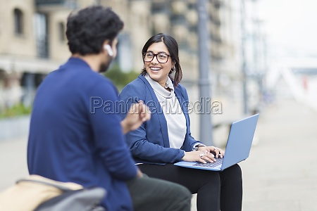 business people working at laptop on