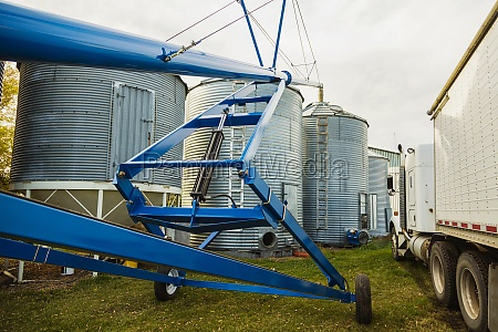 an auger assembly and grain truck